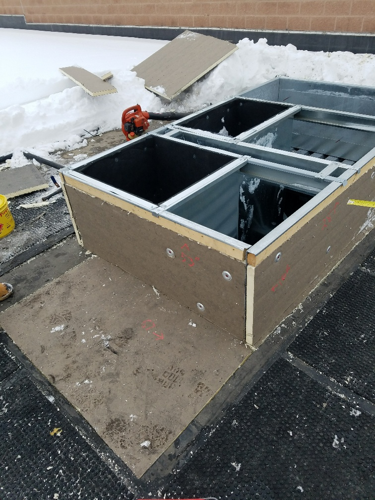5 New Hvac Curb Is Isulated To Prepare For Roof Membrane