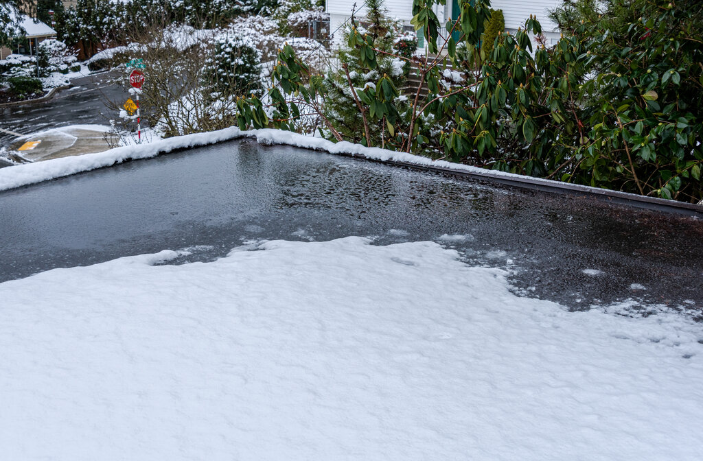 Ice Snow and Water Damage on Commercial Flat Roof